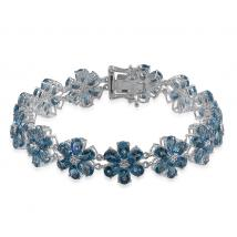 Swiss Blue Topaz (30.60 Ct) Platinum Overlay Sterling Silver Bracelet (Size 7.5)